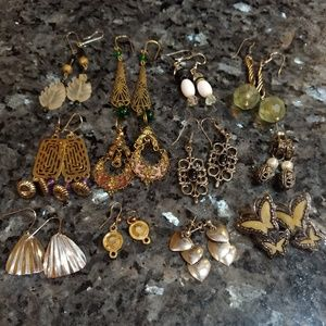 12 pairs of dangling vintage earrings